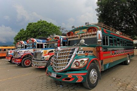 Typical colorful guatemalan chicken bus in Antigua, Guatemala, Central America Editorial