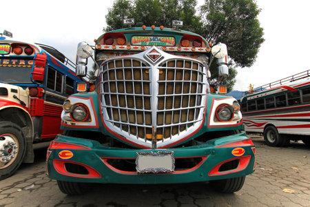 Typical colorful guatemalan chicken bus in Antigua, Guatemala, Central America Editorial