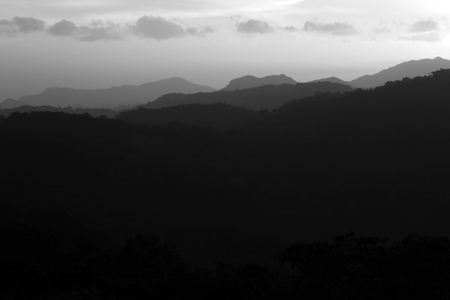 afterglow: Black and grey mountain silhouette.