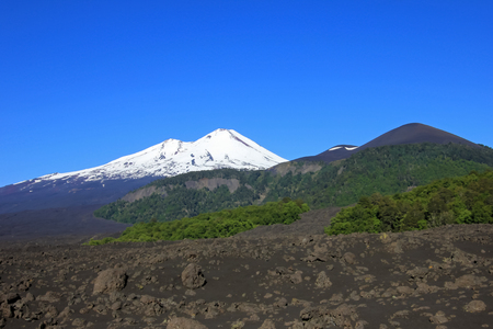 volcan: Snow capped peak of Volcano Llaima, Conguillio National Park, Chile, South America