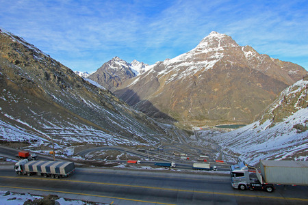 switchback: Truck traffic in the hairpin curves at Paso International Los Libertadores or Cristo Redentor, Chile, South America Stock Photo