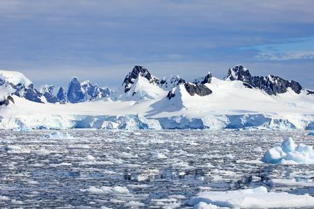 Beautiful mountains and ice floes, Antarctic Peninsula, Antarctica 写真素材