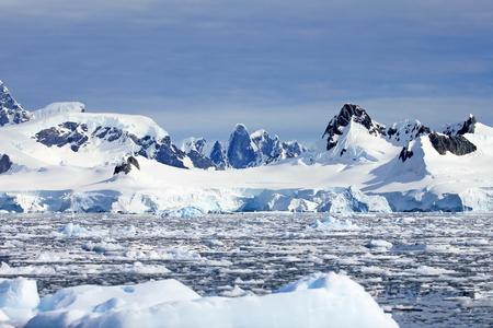 Beautiful mountains and ice floes, Antarctic Peninsula, Antarctica Фото со стока