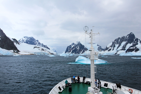 Cruise ship crusing around ice floes in Antarctic waters, Antarctica
