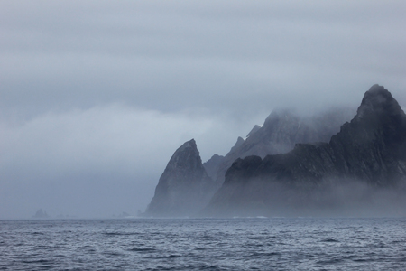 Mountains in fog, Antarctic Peninsula landscape, Antarctica Stock Photo