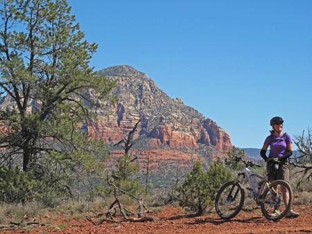 Woman mountain biking in the red rocks, Sedona, Arizona, USA