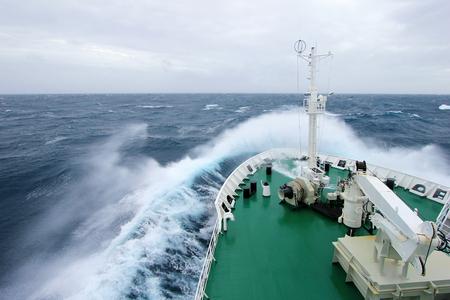 Ships Bow diving into a big splashing wave, antarctic ocean, Antarctica