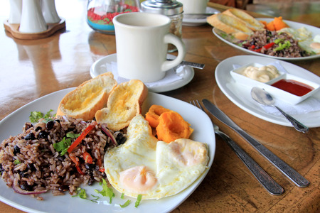 Traditional Gallo Pinto breakfast with eggs, Costa Rica, Central America 스톡 콘텐츠
