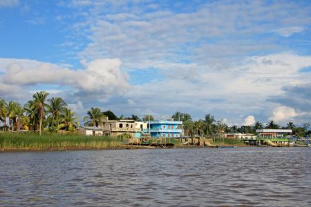 Traditional fishing boats and houses, Cayapas River, Esmeraldas province, Ecuador, South America Banco de Imagens - 90247539
