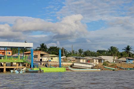 Traditional fishing boats and houses, Cayapas River, Esmeraldas province, Ecuador, South America