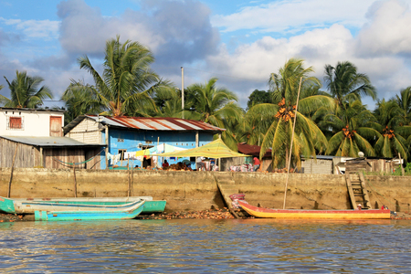 Traditional fishing boats and houses, Cayapas River, Esmeraldas province, Ecuador, South America