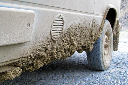 Very dirty muddy van after driving the endless Dalton Highway leading from Fairbanks to Prudhoe Bay, northern Alaska, USA Stock Photo
