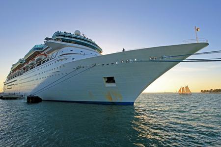 Big cruise ship and small sailing boat, size comparison, Key West, Florida the Sunshine State, USA