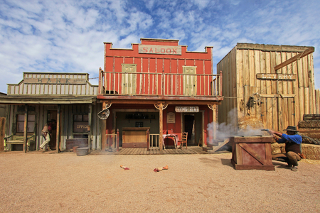 TOMBSTONE, ARIZONA, USA, MARCH 4, 2014: Actors playing the O.K. Corral gunfight shootout on rebuilt stage in Tombstone, Arizona USA on March 4, 2014