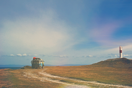 Old german vintage campervan camping at the lighthouse and the bay of Porvernir, retro vintage photo filter effect in pastell colers with light leaks and increased exposure, Tierra Del Fuego, Chile