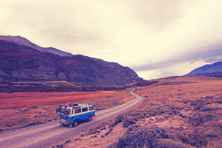 Old german vintage campervan beautiful landscape near Paso Roballos, Nashville retro vintage photo filter effect, warm color temperature, increased exposure and lower contrast, Argentina and Chile, South America
