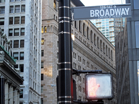 Broadway Street sign, with skyscraper in the background, New York City NYC, USA
