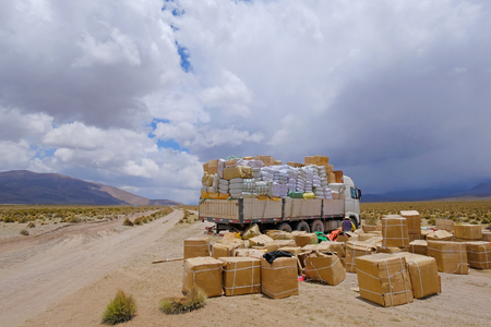 Lost truck load, the load spilled across the gravel road in the high andes mountains of northern Chile, South America Stock Photo