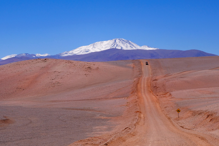 Beautiful Andes landscape and the road leading to Paso Pircas Negras mountain pass, Argentina to Chile, snow covered high mountains in the background, La Rioja, South America