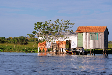House on stilts at the Rio Paraguay river in the Pantanal, near Corumba, Mato Grosso Do Sul, Brazil, South America