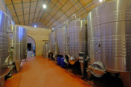 Stainless steel tanks for fermentation in modern Malbec wine factory, San Juan, Argentina, South America, also seen in Mendoza