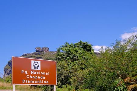 Signpost of the Parque Nacional Chapada Diamantina, portuguese for National Park, on the road to Lencois, Bahia, Brazil, South America
