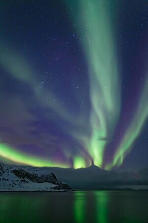 Intense northern lights, Aurora Borealis at a bay near Honningsvag and the Nordkapp, North Cape, Finnmark, Norway, Europe Reklamní fotografie
