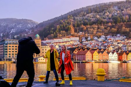 BERGEN, NORWAY, NOVEMBER 30, 2019: Two female singers are playing for a music video as a promotion for the 950th anniversary in the year 2020 in Bergen, Norway on November 30, 2019