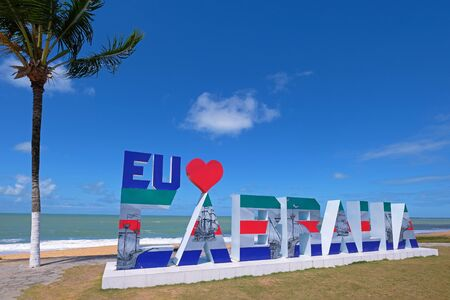 SANTA CRUZ CABRALIA, BAHIA, BRAZIL, AUGUST 29, 2018: Signpost showing Eu Love Cabralia to promote the region and the beach, Santa Cruz de Cabralia, Bahia, Brazil, South America