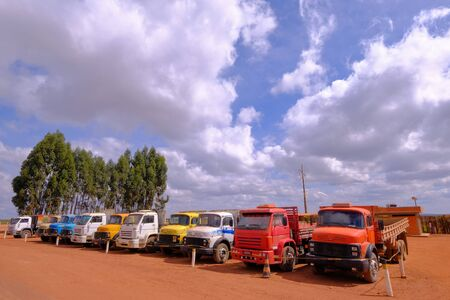 Old vintage trucks of various colors and models in row on a truck stop in the Chapada Diamantina region, Bahia, Brazil, South America Stock Photo