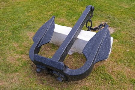 Old marine ship anchor lying on a meadow at the port of Montevideo, Uruguay, South America