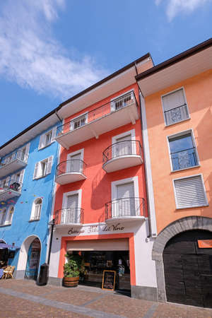 Ascona, Ticino, Switzerland, June 04, 2019: Beautiful colorful houses and wine bodega store in the streets of Ascona, Lago Maggiore lake in Ticino, southern Switzerland, Europe