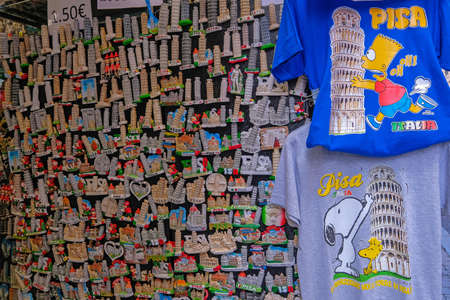 Pisa, Tuscany, Italy, April 05, 2019: Magnets and shirts in a souvenir shop, showing the famous leaning tower of Pisa, Tuscany, Italy, Europe