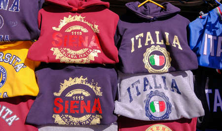 Siena, Tuscany, Italy, March 31, 2019: Sweaters in a souvenir shop, showing the name Siena and Italy, Europe