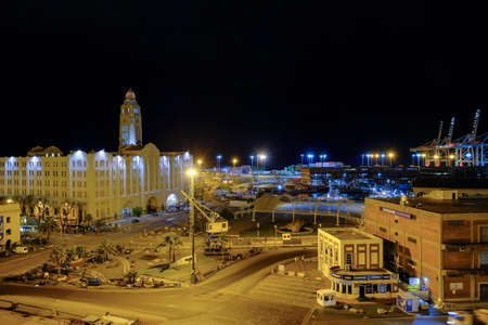 Montevideo, Uruguay, Oct 12, 2018: Entrance of the port of Montevideo harbor with cityscape skyline at night, Montevideo, Uruguay, South America Editöryel