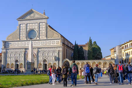 Florence, Tuscany, Italy, March 30, 2019: People at the Church Basilica of Santa Maria Novella in Florence, Tuscany, Italy, Europe