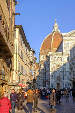 Florence, Tuscany, Italy, March 29, 2019: People at the Cathedral Cattedrale Di Santa Maria Del Fiore in Florence, Tuscany, Italy, Europe