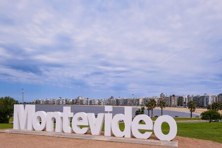 Montevideo written in giant letters at the eastern city access, the skyline in the background, Montevideo, Uruguay, South America Фото со стока