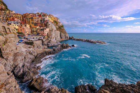 Colorful traditional houses on the rock over Mediterranean sea, Manarola, Cinque Terre, Italy, Europe