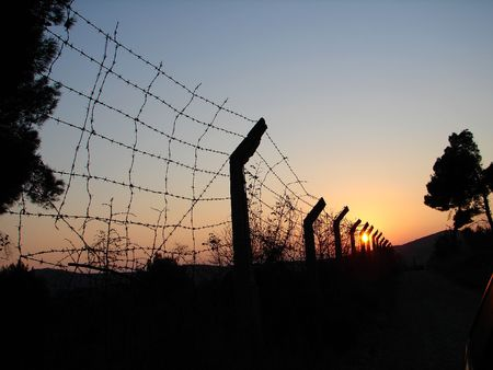 old rusted barbed wire on sunset Stock Photo - 2570056
