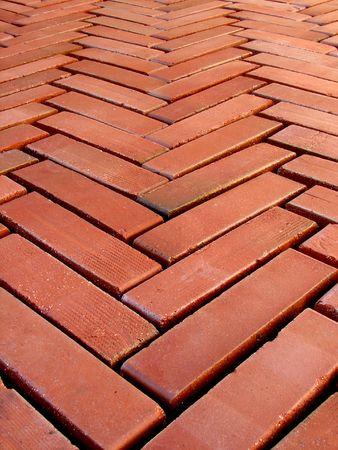 placed: Bricks floor placed in herringbone shape