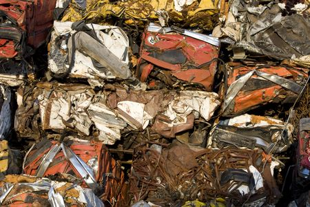 wreckage: Old colorful squashed and coroded  cars dumped
