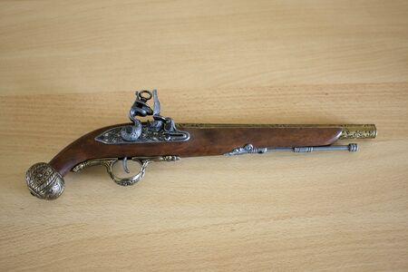 holster: Antique holster on wooden background