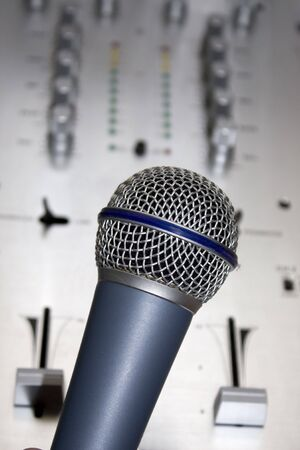 Microphone with audio mixer in background photo