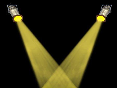 spot lit: Two yellow spot lights on black background