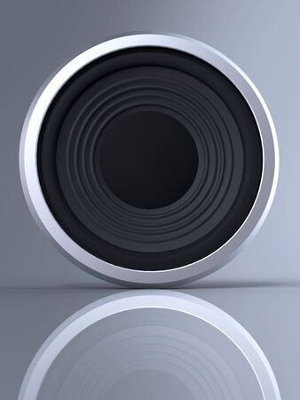Loudspeaker with reflection and shadow on gray background