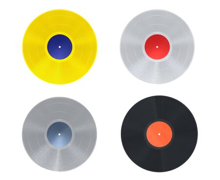 Golden, platinum, silver and black vinyl record on white background photo