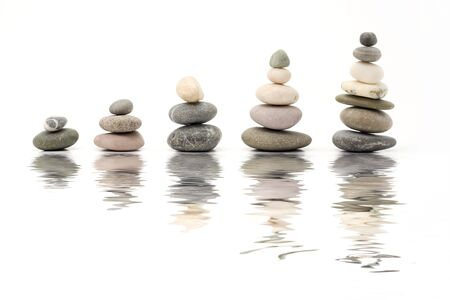 pebbles forming graph on white background with reflection Stock Photo