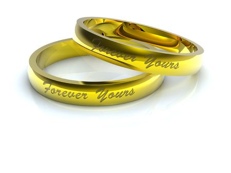 Golden wedding rings with forever yours inscription Stock Photo - 6120371