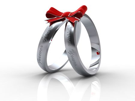 rings: Silver wedding rings with with red bow on white background Stock Photo